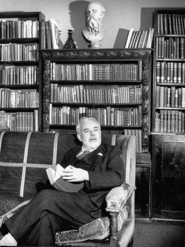 dr-c-e-m-joad-sitting-in-his-library-beneath-a-bust-of-greek-philosopher-socrates