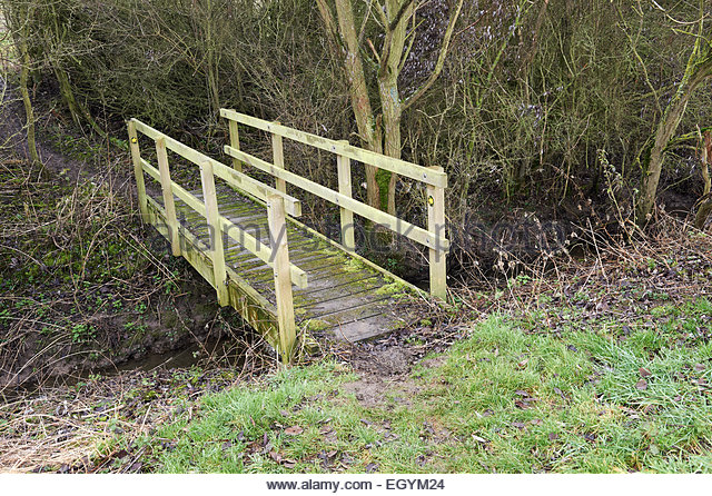 a-wooden-bridge-and-public-footpath-crossing-over-a-natural-brook-egym24